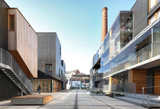 La savonnerie Heymans de Bruxelles, transformée en un ensemble de 42 logements sociaux par les architectes de MDW. Copyright : Filip Dujardin