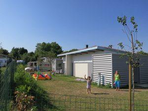 Une résidence de 27 pavillons dédiés aux gens du voyage, livrée en 2012 par Drôles de trames architectes a Bretigny-sur-Orge